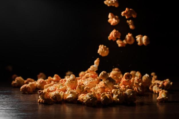 delicious-popcorn-wooden-table-dark_130488-2321.jpg